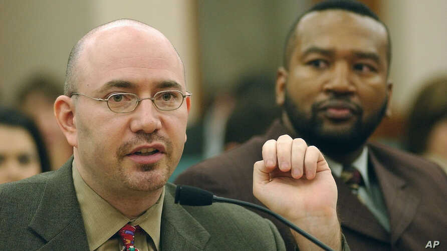 FILE - Mike Feinberg, left, co-founder of the KIPP Academy Charter School in Houston, responds to a question during a meeting in Austin, Texas, Jan. 22, 2004.
