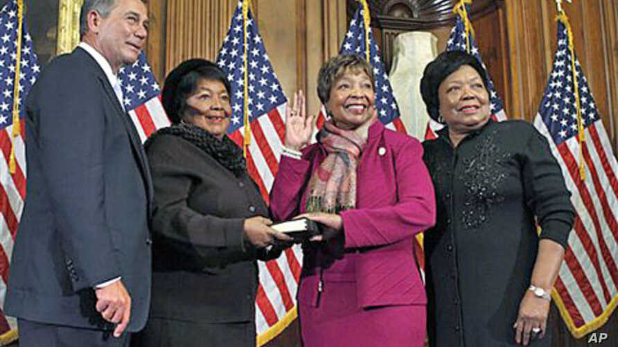 Rep. Eddie Bernice Johnson, D-Texas, second from right, participates in a ceremonial swearing in with House Speaker John Boehner of Ohio, on Capitol Hill in Washington, January 5, 2011 (file photo)
