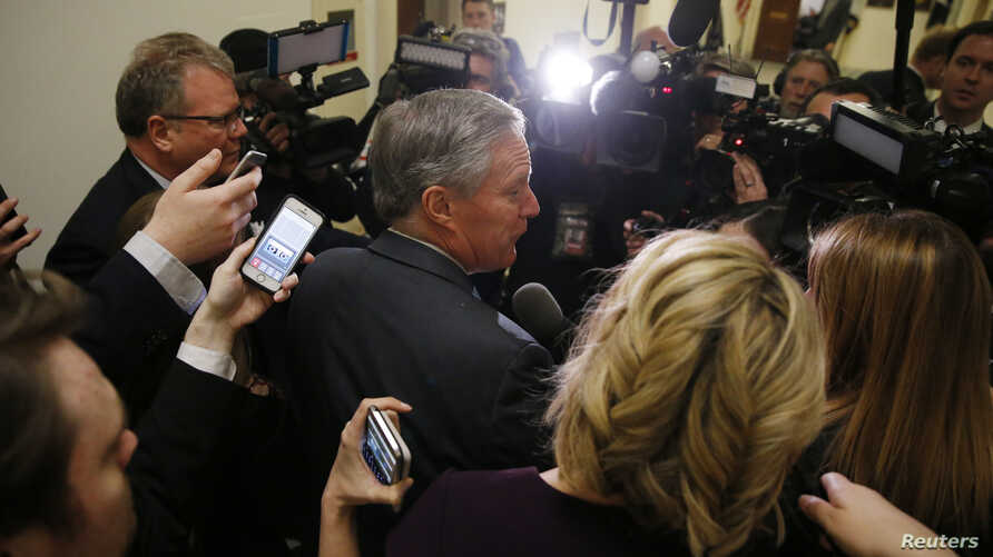 House Freedom Caucus Chairman Rep. Mark Meadows (R-NC) is surrounded by reporters and television cameras as he arrives at a caucus meeting after a trip to the White House to meet with President Donald Trump about the AHCA health care bill in Washingt