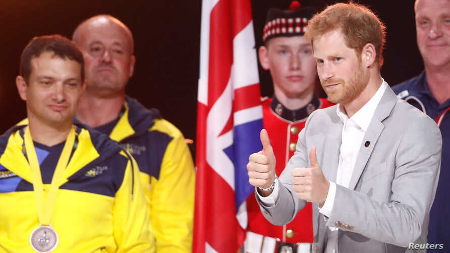 Britain's Prince Harry walks on the stage during the closing ceremony for the Invictus Games in Toronto, Ontario, Sept. 30, 2017.