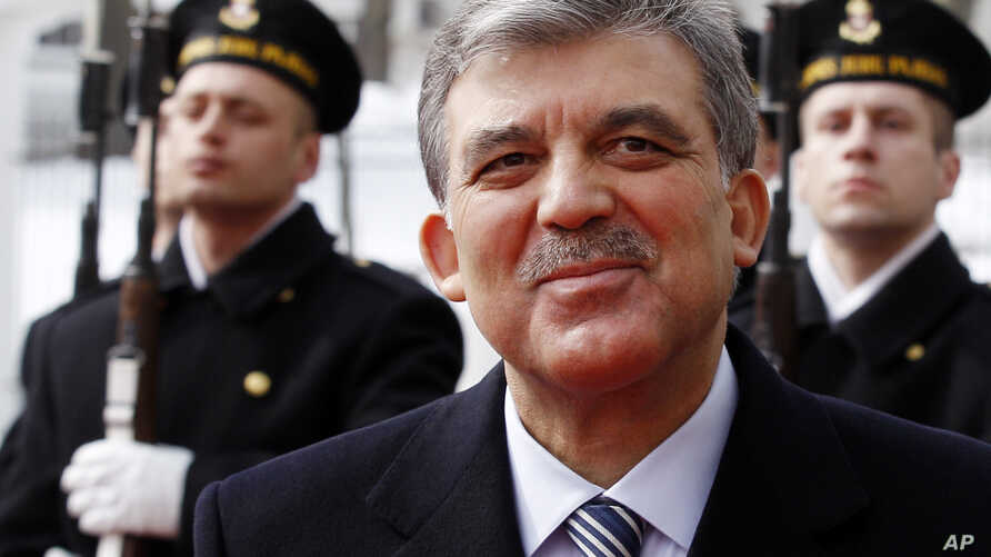 Turkey's President Abdullah Gul reviews the honor guard during a welcome ceremony at the Presidential palace in Vilnius, Lithuania, Wednesday, Apr. 3, 2013.