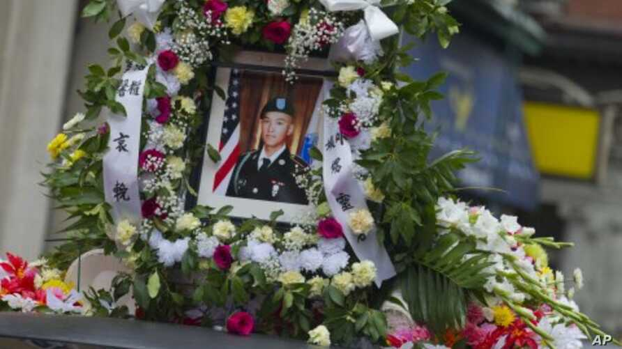 A portrait of Private Danny Chen is displayed on a funeral procession vehicle during the procession in New York, October 13, 2011.