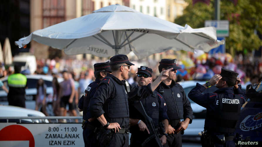 Police officers stand at a road block at the beginning of fiestas in Bilbao, Spain August 19, 2017.
