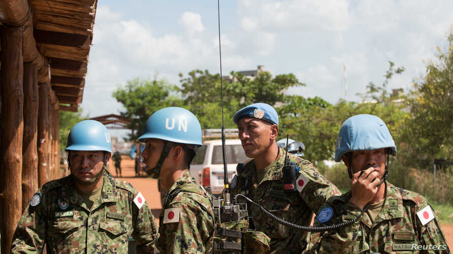 Japanese United Nations Mission in the Republic of South Sudan (UNMISS) troops wait for the arrival of the Japanese minister of defense at the UNMISS base in Tomping Juba on Oct. 8, 2016.