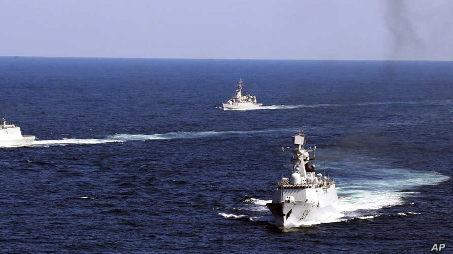 Chinese navy vessels take part in a drill in Zhoushan in east China's Zhejiang province, October 19, 2012.