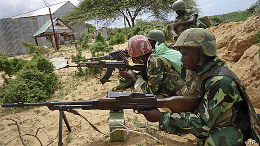 African Union peacekeepers are seen in the Deynile district of the capital Mogadishu, Somalia, October 20, 2011.