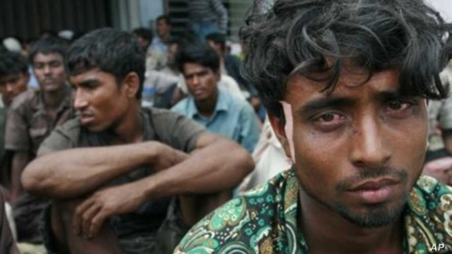 A group of rescued 129 Burma refugees belonging to the Muslim Rohingya minority sits sheltered at the port area in the village of Kreung Raya in Aceh province, February 16, 2011
