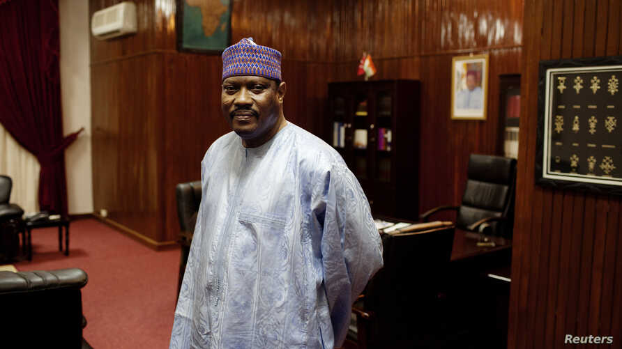Former Niger prime minister Hama Amadou poses for a picture at his office in the National Assembly in Niamey, Sept.16, 2013.