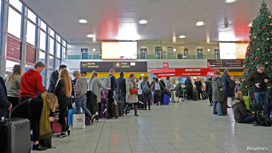 Passengers wait in the South Terminal building at Gatwick Airport after drones flying illegally over the airfield forced the closure of the airport, in Gatwick, Britain, Dec. 20, 2018.