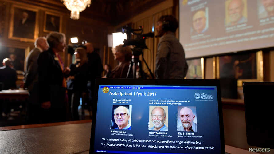 The names of Rainer Weiss, Barry C. Barish, Kip S. Thorne are displayed on the screen during the announcement of the winners of the Nobel Prize in Physics 2017, in Stockholm, Sweden, Oct. 3, 2017.
