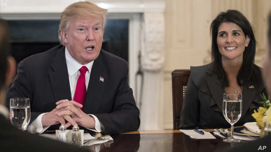 President Donald Trump, joined by U.S. Ambassador to the UN Nikki Haley, right, speaks during a lunch with the United Nations Security Council in the State Dining Room of the White House in Washington, Jan. 29, 2018.