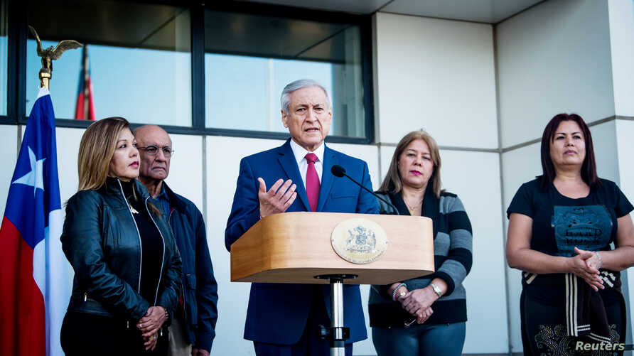 Chile's Foreign Minister Heraldo Munoz speaks to the media as he receives Venezuela's Supreme Court justices, from left,  Elenis Rodriguez, Jose Nunez, Zuleima Gonzalez and Beatriz Ruiz after the judges left the country and arrived to Chile for asylu