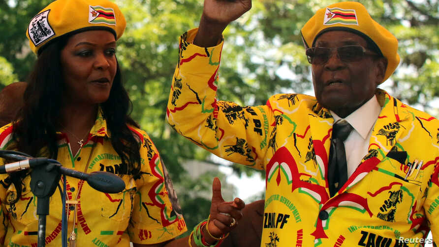 President Robert Mugabe and his wife, Grace, attend a rally of his ruling ZANU-PF party in Harare, Zimbabwe, Nov. 8, 2017.