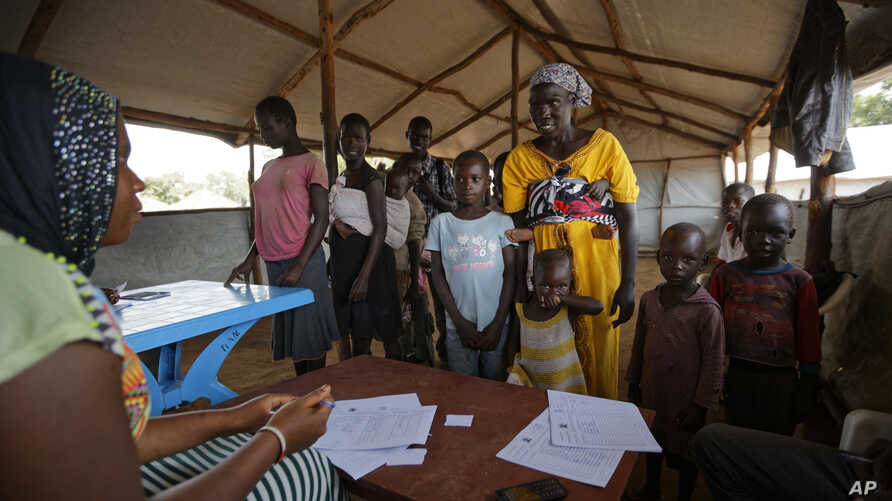A South Sudanese refugee family are registered at a refugee transit center in Kuluba, northern Uganda, June 8, 2017.
