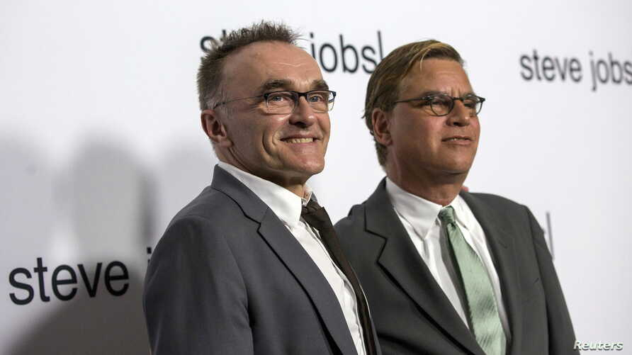 """Director of the movie Danny Boyle (L) poses with writer Aaron Sorkin at an industry screening of """"Steve Jobs"""" at the Academy of Motion Picture Arts and Sciences in Beverly Hills, California, Oct. 8, 2015."""