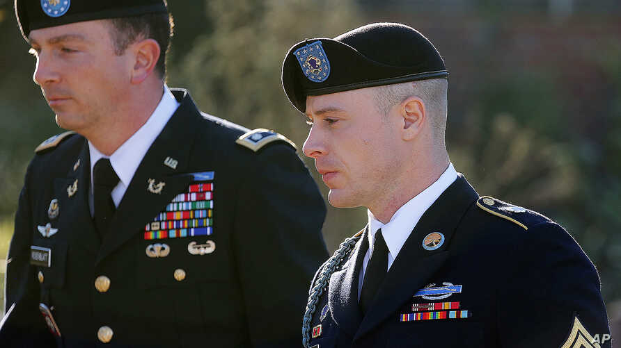 FILE - Army Sgt. Bowe Bergdahl, right, arrives for a pretrial hearing at Fort Bragg, N.C., with his defense counsel Lt. Col. Franklin D. Rosenblatt.