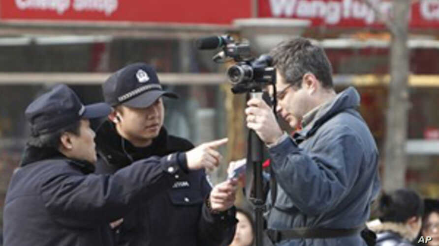 China Blames Protest Clashes on Foreign Media