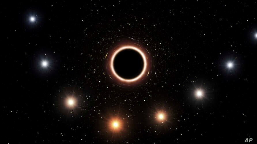 This artist's impression provided by the European Southern Observatory in July 2018 shows the path of the star S2 as it passes close to the supermassive black hole at the center of the Milky Way galaxy.