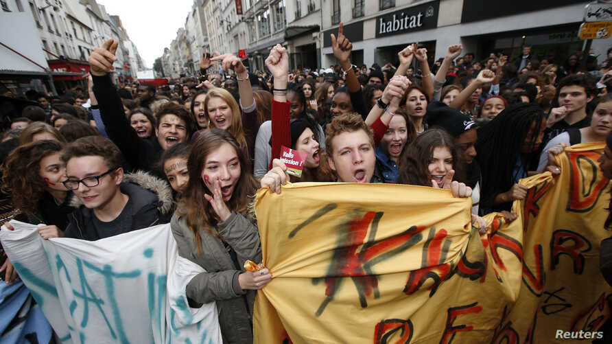 French high school students attend a demonstration in Paris,  Oct. 17, 2013, to protest the expulsion of Kosovar schoolgirl Leonarda Dibrani and another deported student of Armenian descent, Khatchik Kachatryan.