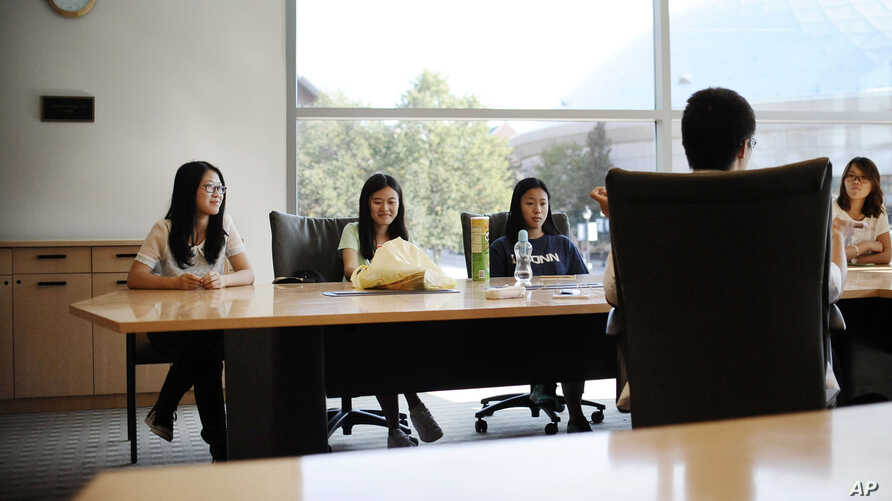 FILE - Students attend a meeting of a Chinese scholars association on the campus of the University of Connecticut in Storrs.