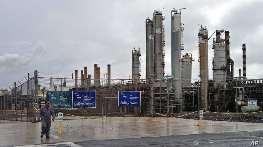 FILE - A worker walks out of the Hovensa oil refinery in St. Croix, U.S. Virgin Islands, Jan. 18, 2012.