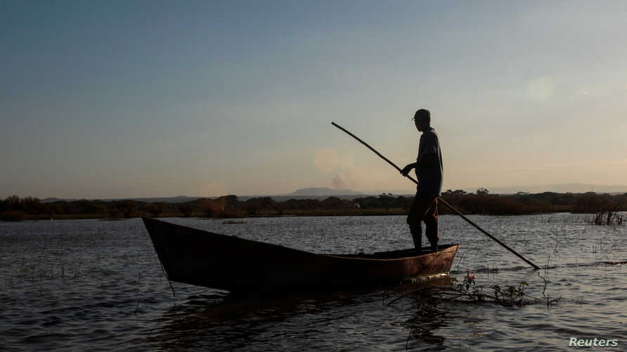 A fisherman stands on his boat as he fishes at the Tisma lagoon wetland park, also designated as Ramsar Site 1141 in the Convention on Wetlands, in Tisma, Nicaragua, April 18, 2018.