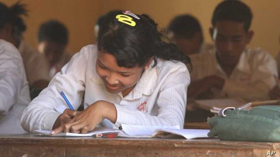 A girl sits in a history class at the local high school in Kampong Trach, Cambodia