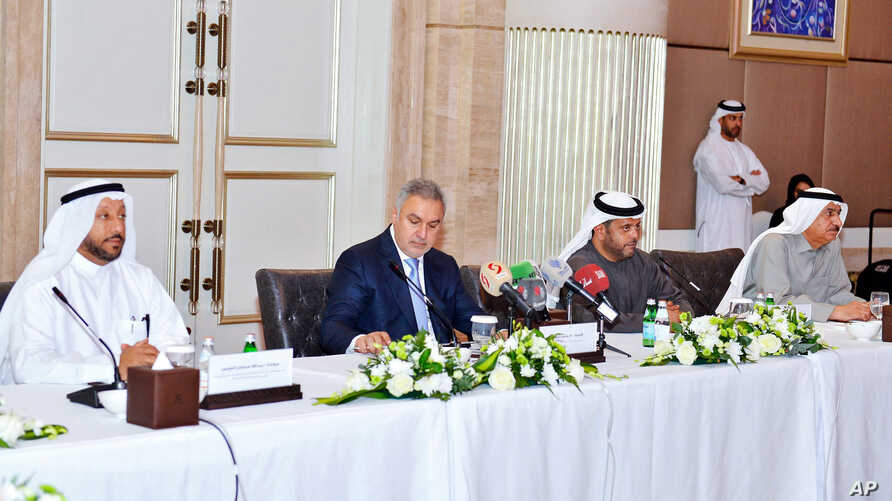 This Jan. 20, 2019 picture made available by the Emirates News Agency, WAM, shows Syrian businessman and lawmaker Mohammed Hamsho, second left, at a trade forum launched Sunday, in Abu Dhabi, United Arab Emirates.
