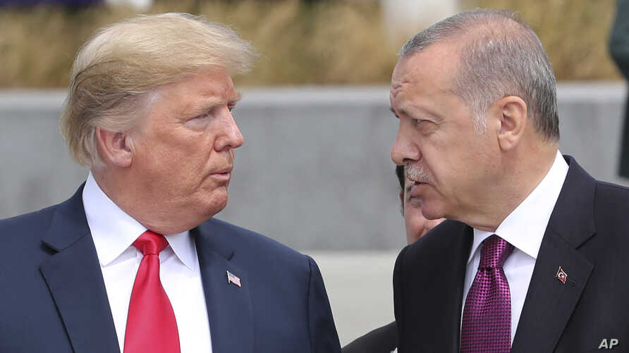 President Donald Trump, left, talks to Turkish President Recep Tayyip Erdogan, right, as they tour the new NATO headquarters in Brussels, Belgium, July 11, 2018.