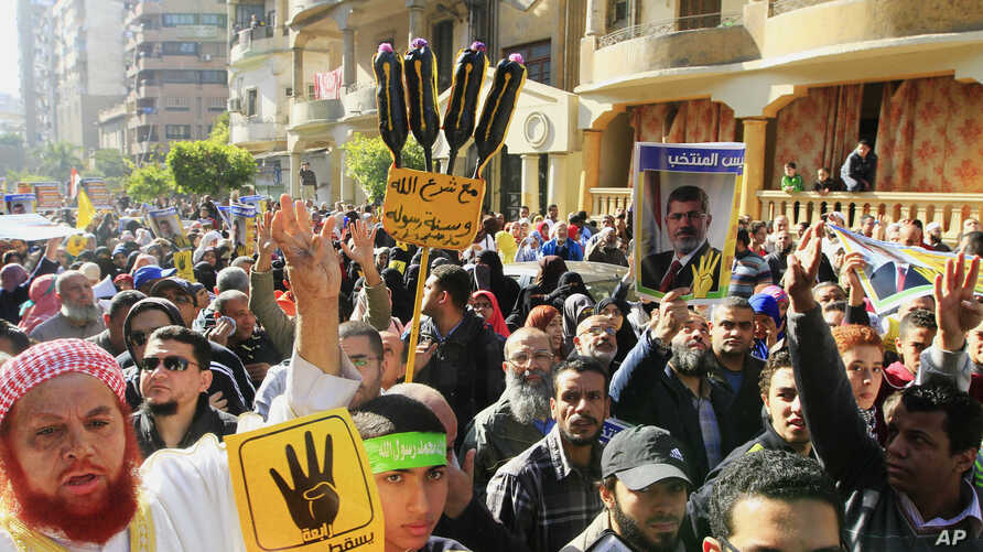 Supporters of Egypt's ousted President Mohammed Morsi march in Cairo, Egypt, Dec. 27, 2013.
