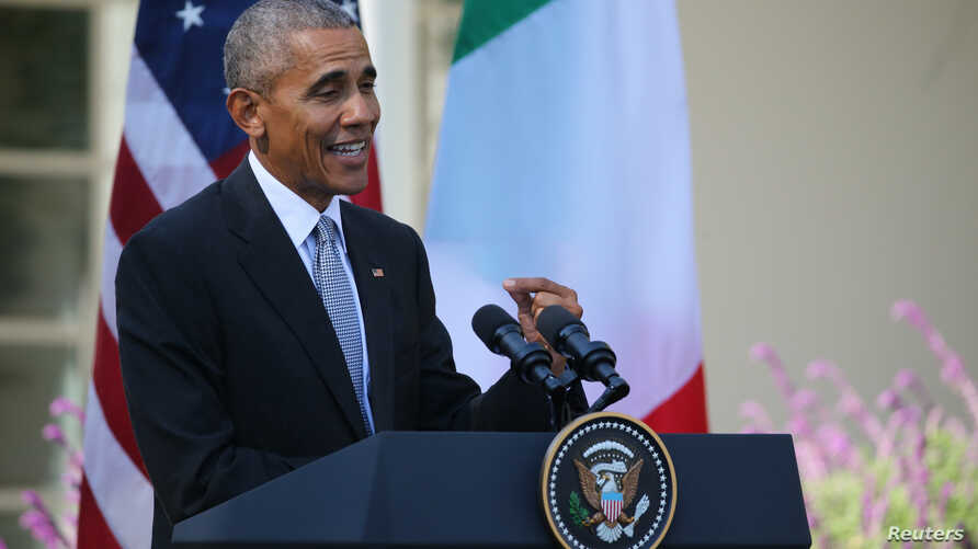 U.S. President Barack Obama speaks during a joint news conference with Italian Prime Minister Matteo Renzi in the Rose Garden of the White House in Washington,  Oct. 18, 2016.