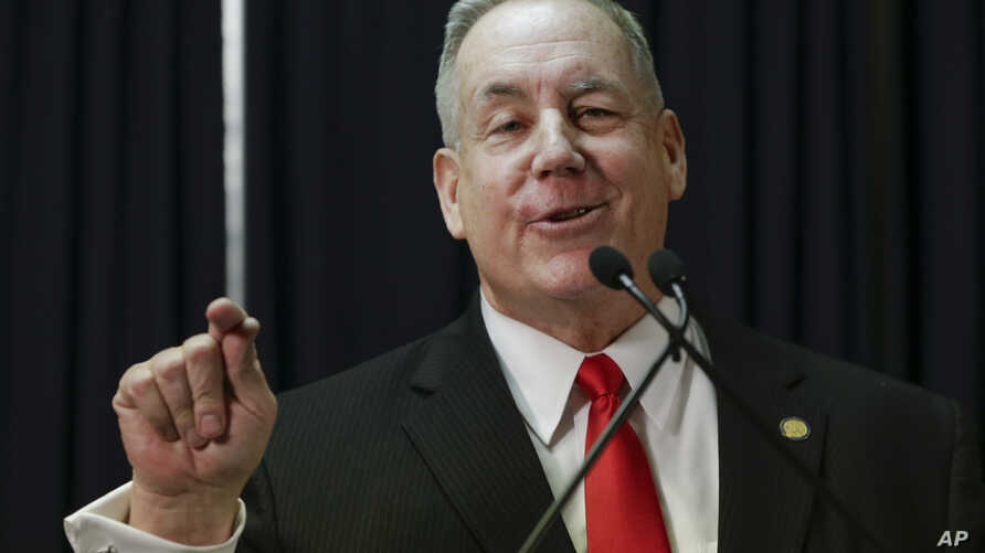 Nebraska state Sen. Bill Kintner of Papillion announces at a news conference in Lincoln, Jan. 25, 2017, that he is resigning the seat he has held since 2012, following an uproar over a tweet he sent that implied Women's March protesters were too unat