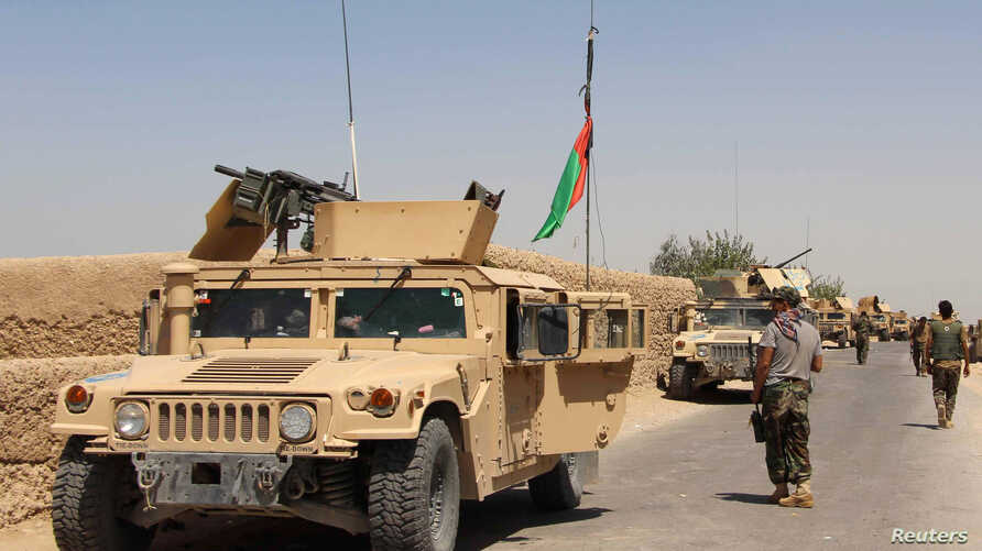 FILE - Afghan National Army (ANA) troops arrive in Nad Ali district of Helmand province, southern Afghanistan, Aug. 10, 2016.