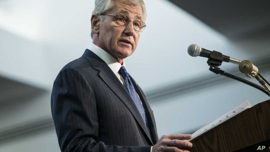 Secretary of Defense Chuck Hagel speaks during a retirement ceremony at the National Security Agency, March 28, 2014, at Fort Meade, MD, for Gen. Keith B. Alexander from the Army and as head of the National Security Agency, the Central Security Servi
