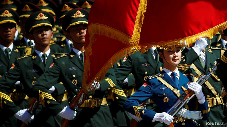 Honour guards march during a welcoming ceremony attended by Chinese Premier Li Keqiang and Canadian Prime Minister Justin Trudeau  at the Great Hall of the People in Beijing, China, August 31, 2016.