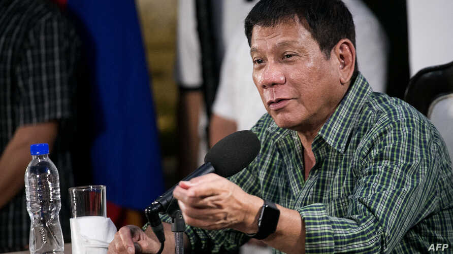 Philippines' president-elect Rodrigo Duterte speaks during a press conference in Davao on May 31, 2016.