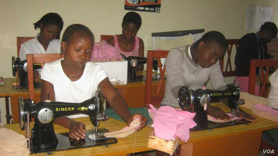 Girls learn to make sanitary pads from imported water-proof materials in project sponsored by the Malawi NGO, Girls Empowerment Network (VOA / L. Masina)