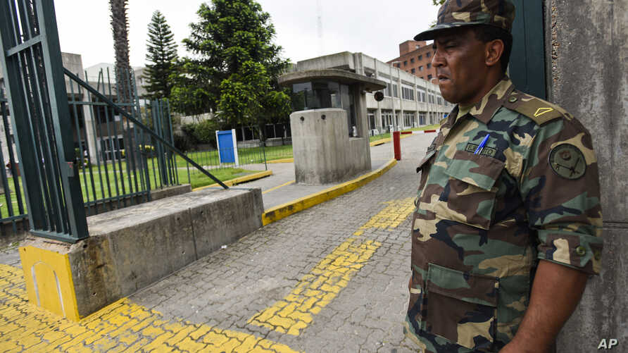A soldier stands guard at the entrance of a military hospital in Montevideo, where six former Guantanamo Bay prisoners are undergoing medical checks after being resettled in Uruguay, Dec. 8, 2014.