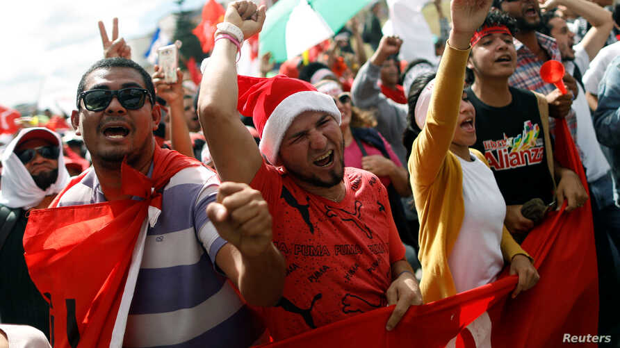 Supporters of Salvador Nasralla, presidential candidate for the Opposition Alliance Against the Dictatorship, demonstrate during a march as they wait for official presidential election results in Tegucigalpa, Nov. 29, 2017.