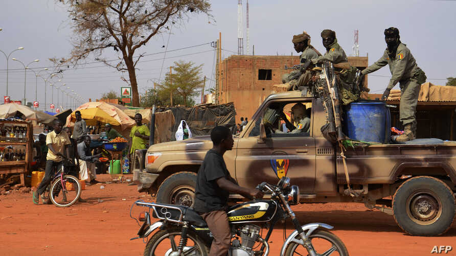 A file photo taken on Jan. 26, 2013 shows Chadian soldiers on a truck leaving Niamey for the Malian border.