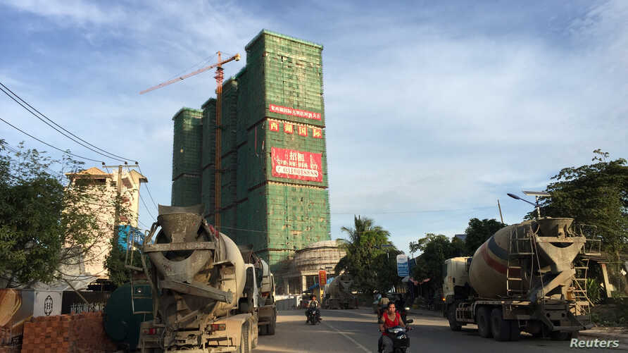 FILE - A Chinese hotel and entertainment complex under construction is seen at the Preah Sihanoukville province, Cambodia, Nov. 26, 2017.