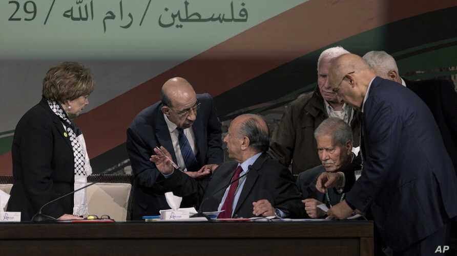 Fatah members talk ahead of the opening session of the Fatah party conference in the West Bank city of Ramallah, Nov. 29, 2016. The  gathering of the ruling Fatah party sent a disheartening message to young Palestinians since most of those elected to