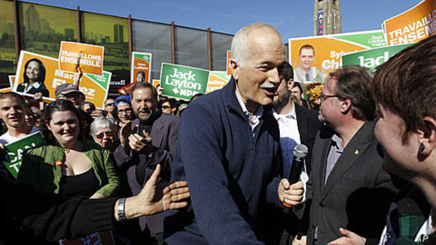 New Democratic Party (NDP) leader Jack Layton greets supporters during a campaign stop in the Montreal, May 1, 2011
