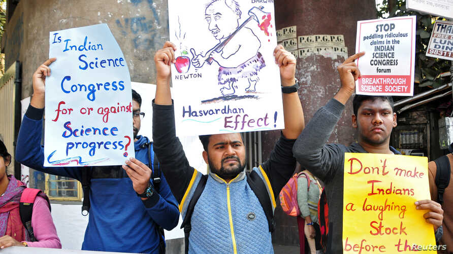 People hold placards to protest claims made by speakers, discrediting theories of Isaac Newton and Albert Einstein, at the 106th Indian Science Congress in Kolkata, India, Jan. 7, 2019.