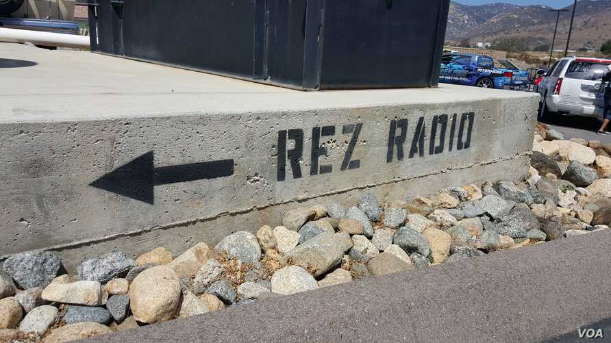 Photo of painted curb outside of the Pala Band of Mission Indians' Pala Rez Radio 91.3 in Pala, California.