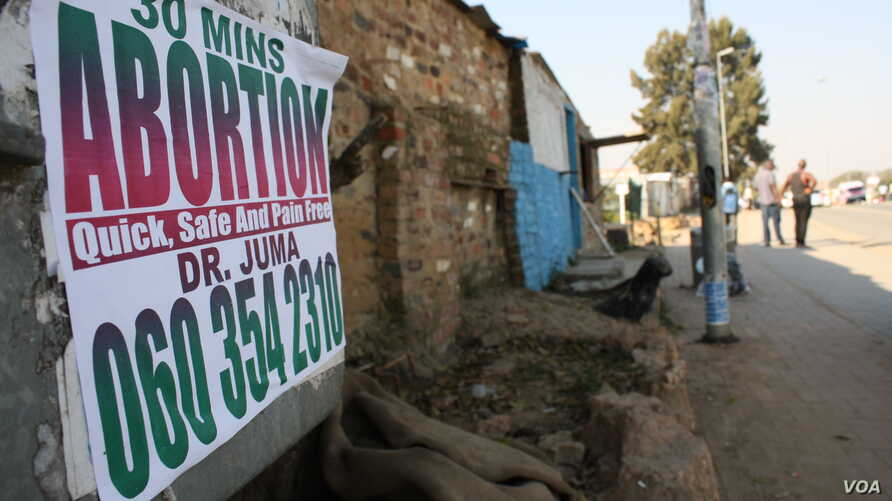 In South African townships, there are plenty of advertisements offering illegal abortions, but little education about HIV. (D. Taylor/VOA)