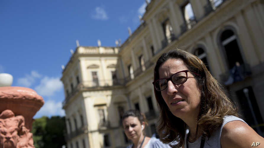 Deputy Director of Brazil's National Museum Cristiana Serejo talks with the media outside the museum that suffered a fire in Rio de Janeiro, Sept. 5, 2018.