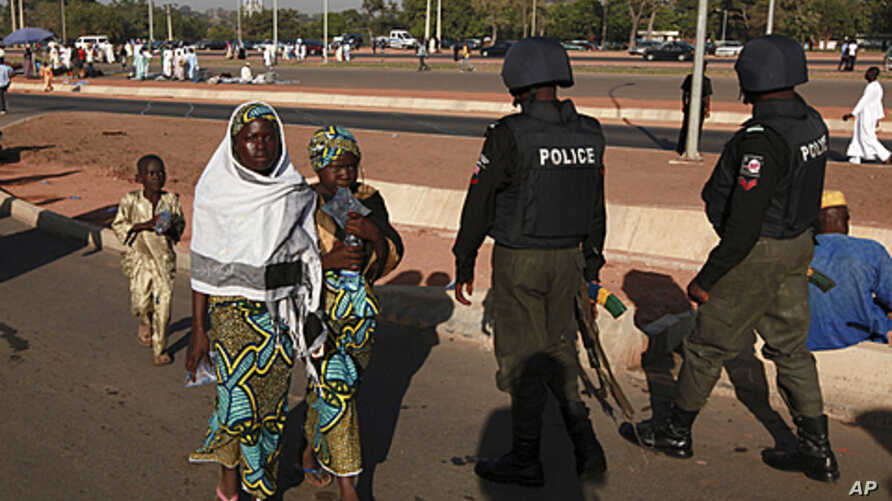Nigerian police patrol as people attend prayers marking the muslim festival of Eid al-Adha in the capital Abuja, November 6, 2011.