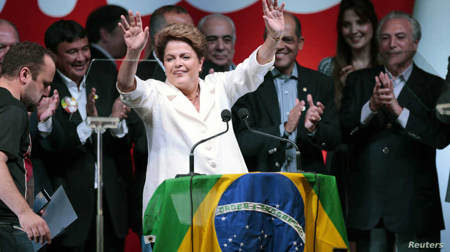 Brazil's President and Workers' Party (PT) presidential candidate Dilma Rousseff reacts during news conference to the election results, in Brasilia Oct. 26, 2014.