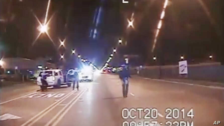 In this Oct. 20, 2014 frame from dash-cam video provided by the Chicago Police Department, Laquan McDonald walks down the street moments before being shot by police officer Jason Van Dyke.